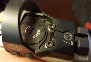 Close up shot of the Romeo1's top load battery compartment. Tighten well before shooting.